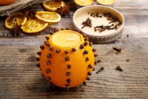 sinaasappel-kruidnagel waxinelicht houder
